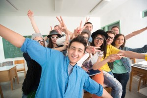Cheerful classmates posing in classroom